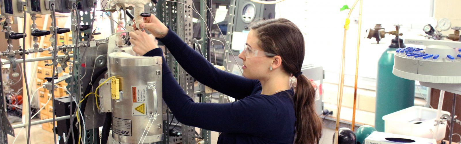 Photo of student researcher in the lab